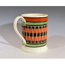 Engine-turned Mocha Pearlware Banded Tankard with Unusual Design
